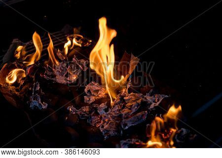 Barbecue Fire Grill On Black Background.burning Charcoal. Focus Is On Hot Coals In The Fire.burning