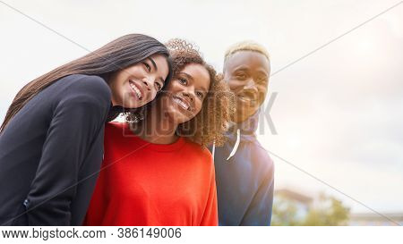 Multi Ethnic Friends Outdoor On Photo Shooting Looking At Camera. Diverse Group People Afro American