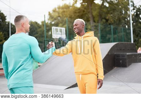 Multi-ethnic Friendship Black African-american And Caucasian Guy Friends Spending Time Together On S