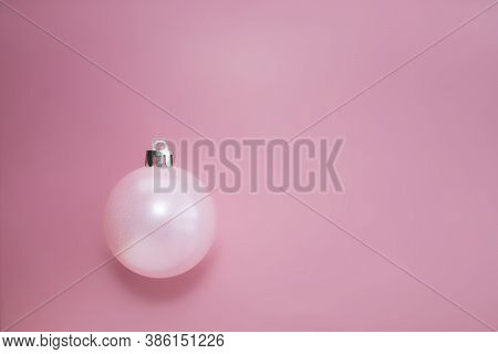 Christmas Pink Ball With A Shadow On A Pink Background. Pink Concept. Place For Your Text