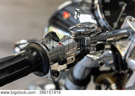 Toggle Switches On Motorcycle Handlebars Controls High And Low Beam Lights And Turn Signals.