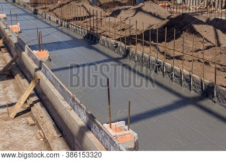 Concreting The Base Of The Building. Construction Worker Concrete Pouring During Commercial Concreti