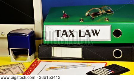 Tax Law-text Inscription On The Folder Of The Office Registrar Against The Background Of Office Supp