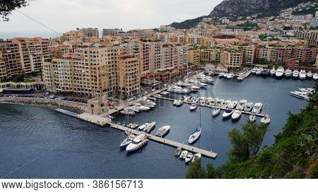 Harbor For Boats In Monte Carlo Surrounded By Residential Houses, Hotels. Boats At European Pier Sho