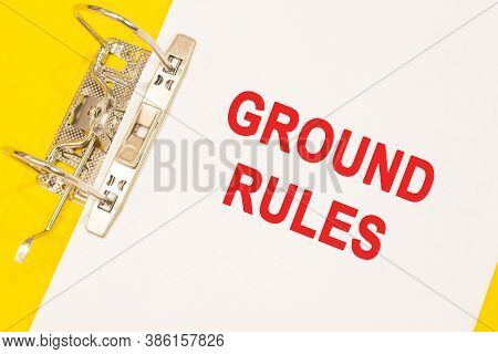 The Word Ground Rules On A White Background With A Yellow Folder. Business Concept