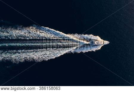 Aerial View On Fast Boat On Blue Mediterranean Sea At Sunny Day. Fast Ship On The Sea Surface. Seasc