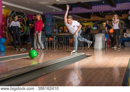 The Bowling Guy Threw The Ball In Flight, A Strong Caucasian Serve. Russia, Moscow - Sep 20, 2020
