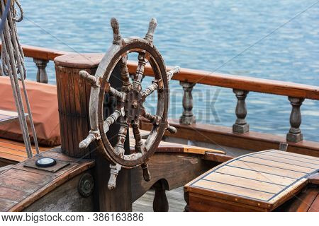 steering wheel made of wood on a yacht