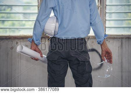 Engineer Arm Hands Holding Hardhat White Work Helmet Hard Hat For Civil Construction Engineering. Co