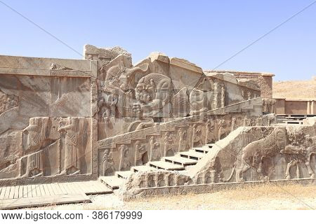 Famous bas-relief on the wall in ancient city Persepolis,  Iran. The lion attacks the bull and bites it (symbolizes fertility of earth and change of seasons of year). UNESCO world heritage site
