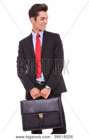 young business man holding a briefcase and looking to his left side on white background