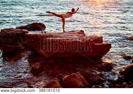 Stretching And Pilates On Fresh Air Concept, Copy Space. Female Standing In Yoga Position. Beautiful