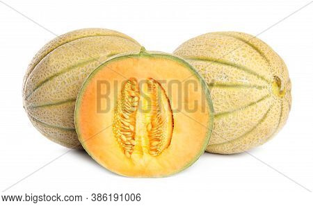 Tasty Cut And Whole Fresh Melons Isolated On White