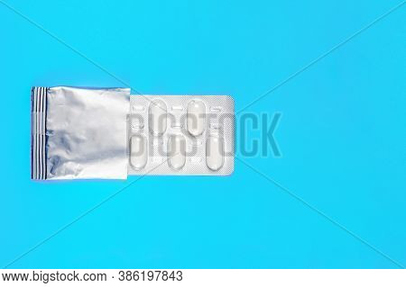 Pills In Blister Packs On A Blue Background. Copy Space. Flat Lay. Medical Background