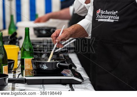 September 28 2019, Charmey, Fribourg, Gruyeres, Switzerland : Men Are Cooking The Half-and-half Fond