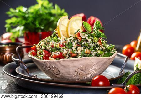 Parsley Salad Or Tabbouleh Classic Vegetarian Dish With Bulgur, Tomatoes, Parsley, Spring Onion And