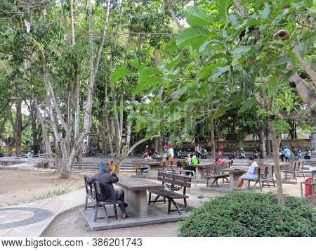Denpasar, Indonesia - September 28, 2019: Some People Sitting On The Park Bench At Puputan Badung Sq