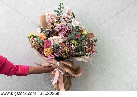 Womans Hand Holds A Bouquet Of Different Flowers, Wedding And Gift Concept, Close Up