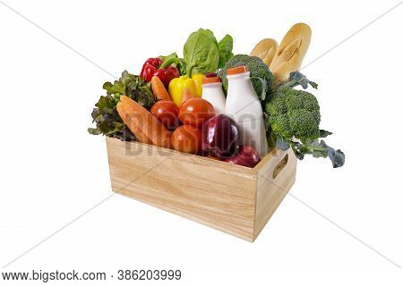 Wooden Crate With Multi Collor Vegetables , Fruit, Milk And Baguette Isolated On White Background. G