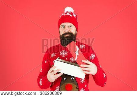 Handsome Man Celebrate Winter Holidays Red Background. Christmas Shopping. Secret Santa Could Ease H