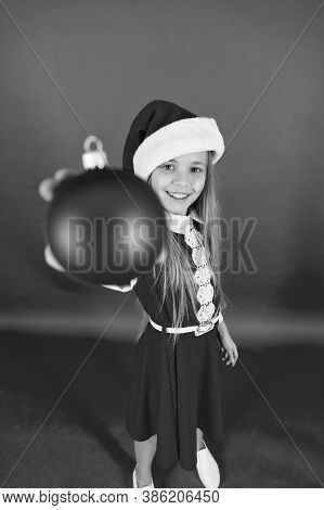 Happy Child Red Costume Hold Christmas Ornaments Close Up Selective Focus. Shop For Decorations. Tak