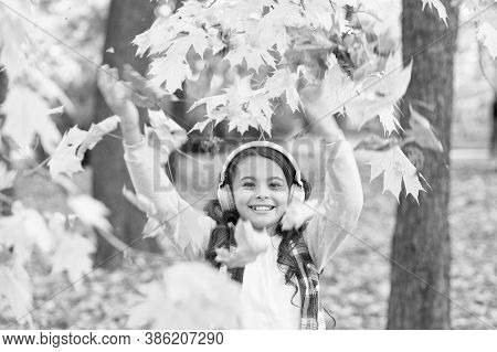 Energetic Song That Gets Her Moving. Energetic Child Have Fun With Yellow Leaves. Small Girl Enjoy E