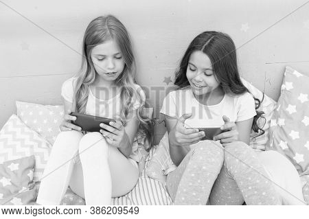 We Are More Connected Than Ever. Little Children Use Mobile Phone In Bed. Mobile Communication. Cell