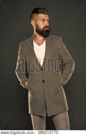 Serious Concentrated Man. Caucasian Man With Brutal Appearance. Bearded Man With Moustache And Beard