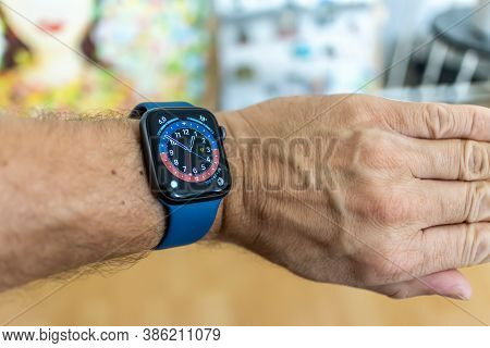 Frankfurt, Germany - September 17th 2020: A german photographer installing the all new watchOS 7 sof