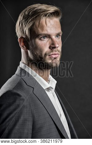 Man Bearded Strict Face With Hairstyle, Dark Background. Masculinity Concept. Businessman Attractive