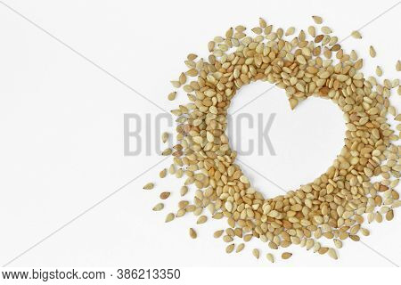 Sesame Seeds In The Shape Of Heart On White Background - Sesame Seeds Are Good For Heart Healthy