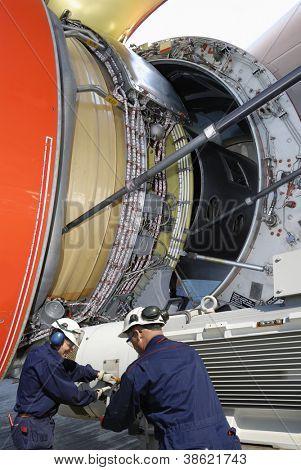 airplane mechanics calibrating large jet engine, standard practice