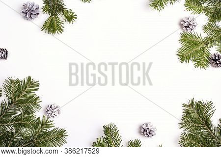 Green Christmas Fir Tree Branches With Cones And Copy Space. Christmas Green Framework Isolated On W