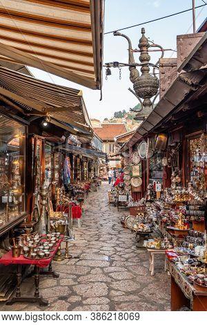 Sarajevo, BiH - August 28, 2019: Tradigional girf shops in historical center of Sarajevo, Bascarsija. Shopping bosnian souvenirs in Sarajevo old town