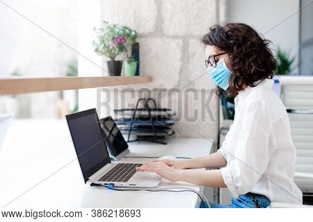 Worker Wearing Protective Mask In Safe Office. Protection Employees On Workplace At Hotel Reception.