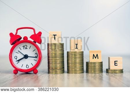 Red Alarm Clock Coin Ladder Is Labeled As Time Placed On A Pile Of Coins. Money Saving Ideas Investi