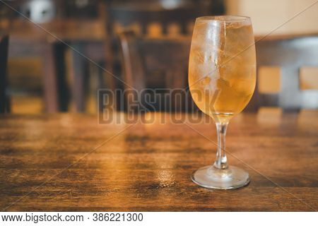 Iced Tea With Ice Refreshing Drink On Wooden Table At Japanese Restaurant. Barley Tea