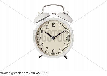 White Vintage Alarm Clock On White Background Isolated