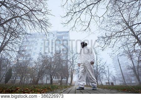 Full Length Of Male Environmentalist In Radiating Suit Standing On Sidewalk On Foggy Street. Ecologi