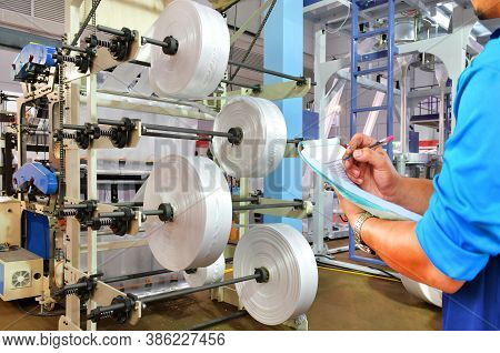 Manager Engineer Checking Automated Production Line Plastic Bag Industrial