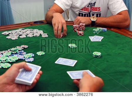 Poker table with chips lying on it poster