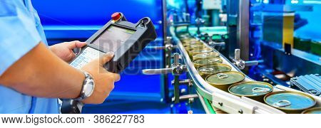 Manager Check And Control Automation Canned Food Products On Conveyor Belt In Distribution Warehouse