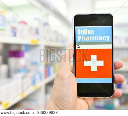 Pharmacist Holding Touch Pad For Search Bar On Display In Pharmacy Drugstore Shelves Background.onli