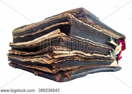 An Ancient Church Book With A Thick Wooden Cover Covered With Leather. An Ancient Manuscript.the Old
