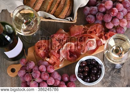 Antipasto. Wine Set   Snack Sun-dried Ham  Jamon With Grapes And Olives
