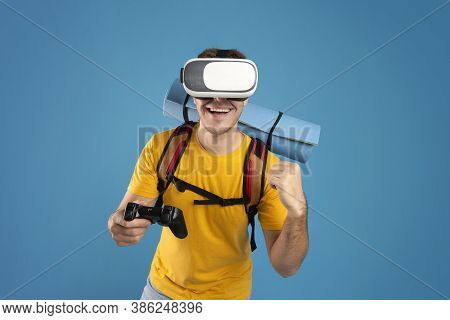 Happy Male Tourist With Vr Headset And Joystick Watching Virtual Travel Tour, Having Vacation Or Jou