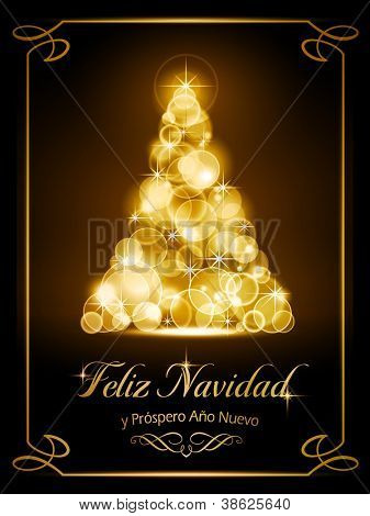 """Warmly sparkling Christmas tree made of our of focus  lights on dark brown background with the text """"Feliz Navidad y Pr�³spero A�±o Nuevo""""."""