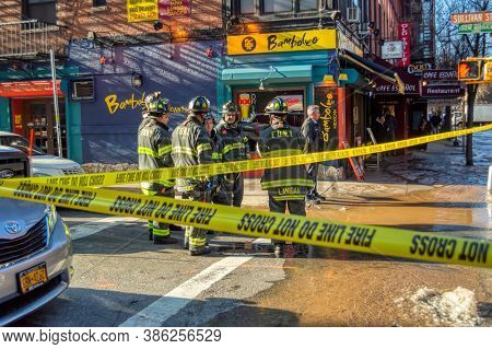 USA, New York 1.14.2015 , Lower Manhattan, NY 10012, United States, F.D.N.Y  firefighters in town action faulty water pipe