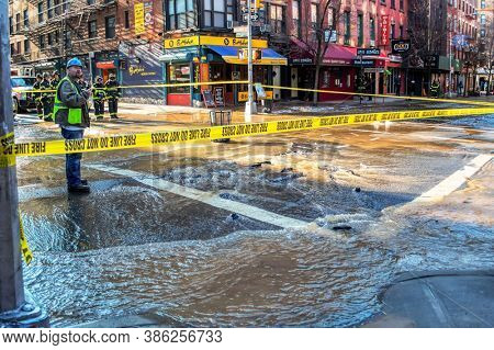 USA, New York 1.14.2015 , Lower Manhattan, NY 10012, United States, F.D.N.Y  firefighters in town repairing  faulty water pipe