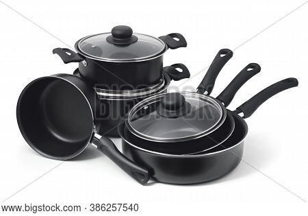 Set Of Black Non-stick Kitchen Utensils On A White Background. Pot, Ladle, Frying Pan  With Glass Li